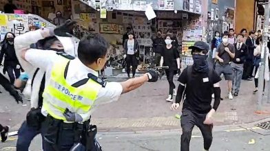 One shot by police and another set alight. What's the latest in Hong Kong?